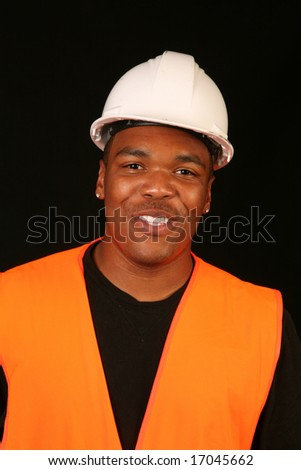 an african american construction worker isolated on a black background