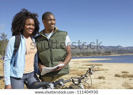 An African American couple with road map