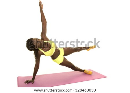 An African American doing a side plank with her arm and leg up.
