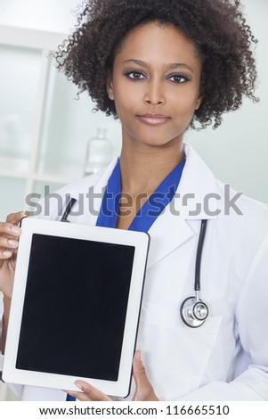 An African American female woman medical doctor with a tablet computer in hospital
