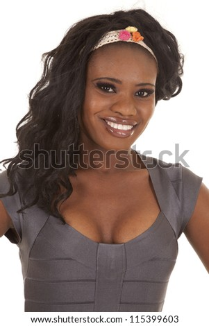 An African American in her gray top and head band smiling.