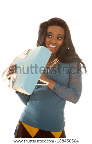 An African American looking in to her purse with a scared expression on her face. - stock photo