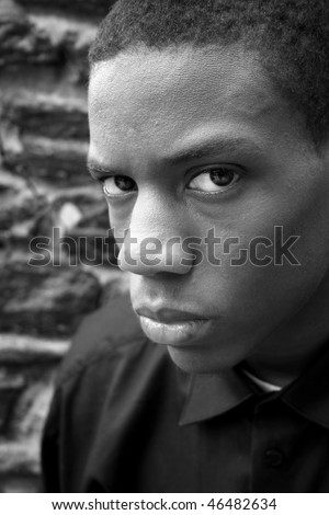 An african american male looking at the camera - stock photo