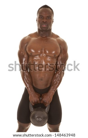 An African American man shirtless holding a weight. - stock photo
