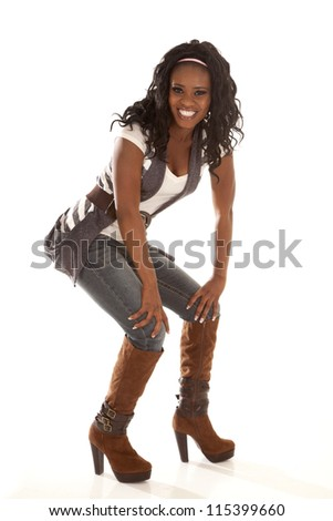 An African American showing off her style with a smile on her face.