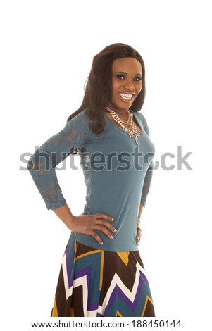 An African American standing in her dress with a big smile. - stock photo