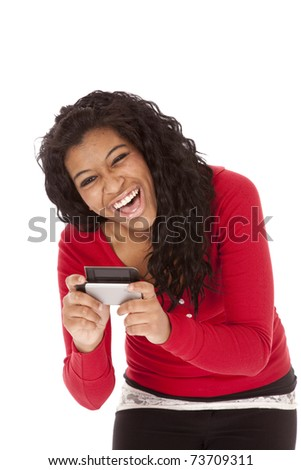 An African American woman is very happy with her cell phone. - stock photo