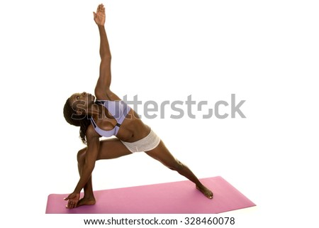 An African American woman leaning over stretching out her body. - stock photo