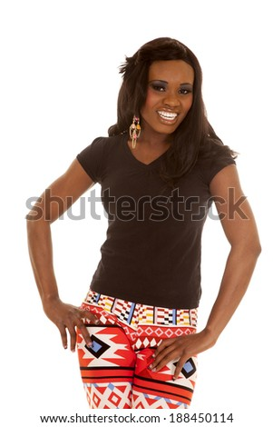 An African American woman with her hands on her leggings with a smile. - stock photo
