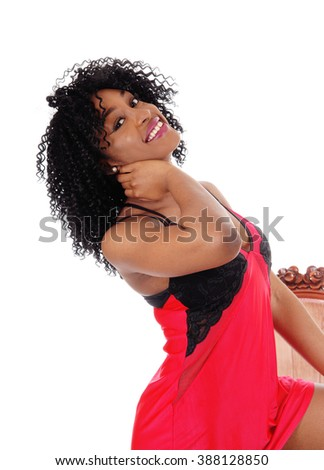 An African American women in a closeup image isolated for white background in red lingerie. - stock photo