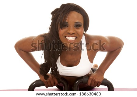 an African American working out, doing a push up. - stock photo