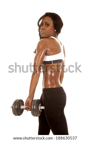 An African American working out with weights.