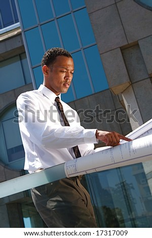 An African-American young urban professional architect surveying the city