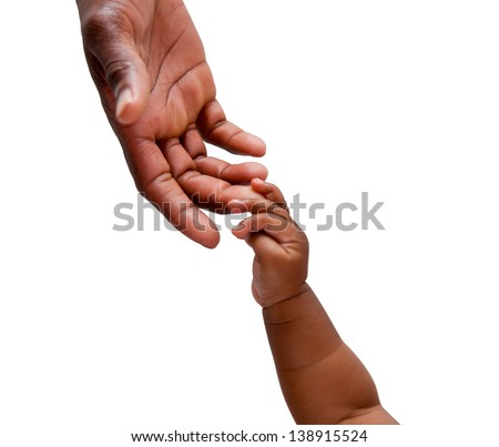 An african baby's hand reaching up to its father's hand shot on an isolated background - stock photo