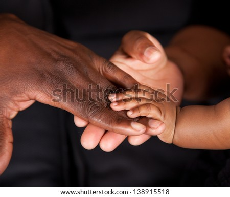 An african family's hands coming together - stock photo