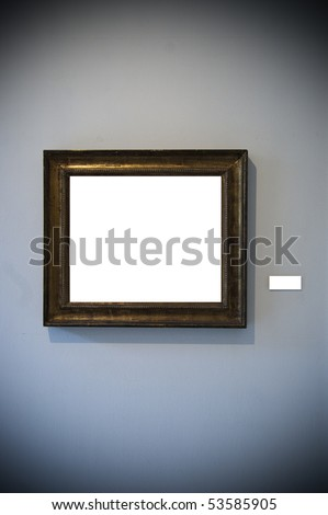 An aged frame on a white wall - stock photo