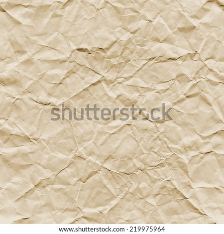 An aged looking tea-stained, crumpled paper texture. Seamlessly Repeatable. - stock photo