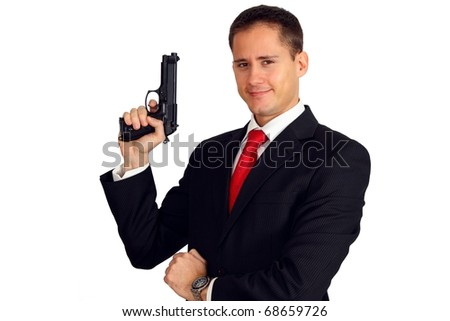 An agent posing with his gun - stock photo