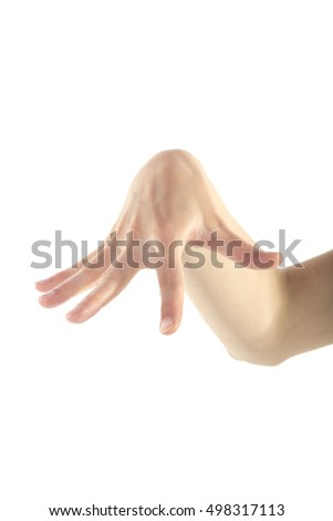 An aggressive female hand is reaching with her right hand on isolated white background.