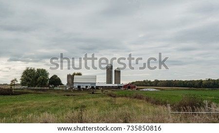 An Agricultural Background Of A Dairy Farm In Rural Wisconsin Countryside