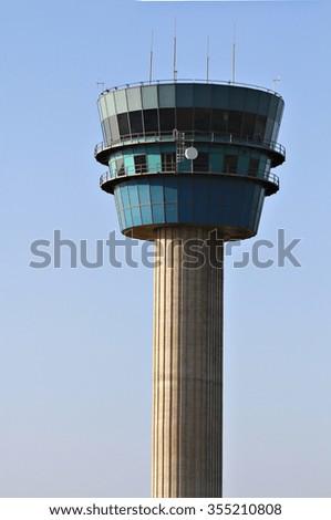 An air traffic control tower. - stock photo