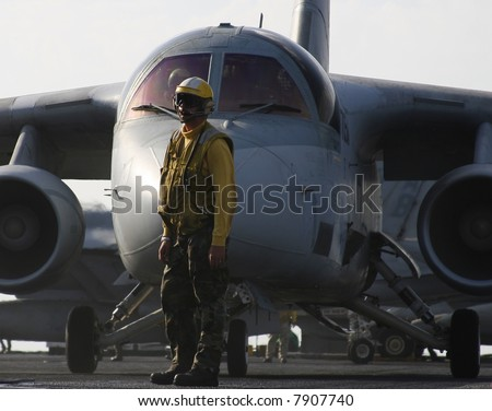 An Aircraft Director Waits in Front of an S-3B Viking for Launch Aboard a Nuclear Aircraft Carrier