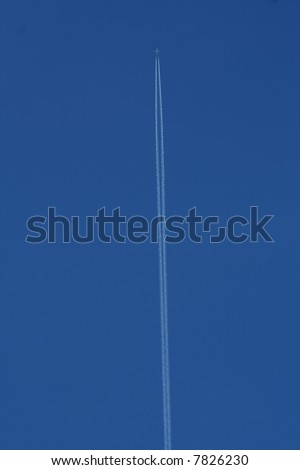 An airliner leaves a vapour trail across a cloudless blue sky