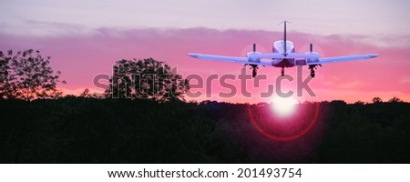 An airplane flying into the sunset, the ultimate symbol of freedom - stock photo