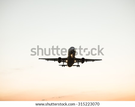 An airplane landing at an airport