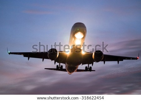 An airplane landing at an airport - stock photo