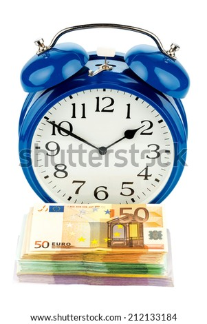 an alarm clock and banknotes, symbolic photo for wage costs, labor costs, time work - stock photo