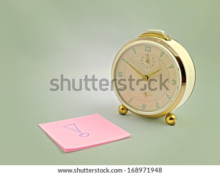 An alarm clock from the 60ies and note - stock photo