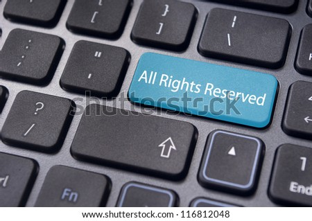 an All Rights Reserved message on keyboard to illustrate the concepts. - stock photo