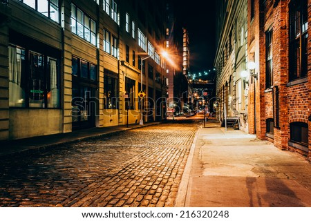 An alley at night, in Brooklyn, New York. - stock photo