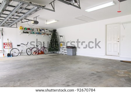 An almost empty garage to be used as storage for junk that will be collected over the years