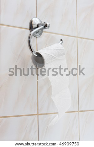 An almost empty roll of toilet paper - stock photo