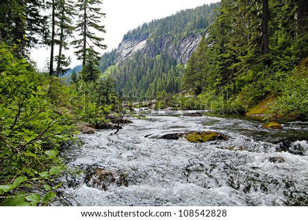 An alpine river flowing from Dorothy Lake in the Cascade Mountains. - stock photo