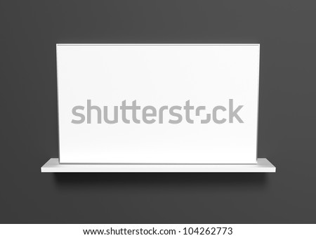 An aluminum frame with a white picture standing on a white shelf on a black background.