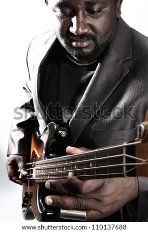 an american african bass player on white background - stock photo