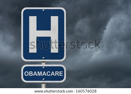 An American blue road sign with a stormy sky background with a capital H and word Obamacare, Hospital and Obamacare - stock photo