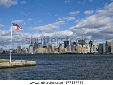 An American flag in a harbor in front of a city. - stock photo