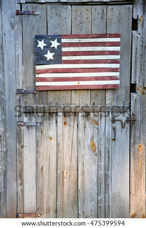 An american flag on a barn