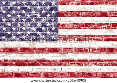An American flag on a brick wall used as a wallpaper or background - stock photo