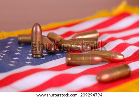 An American flag with bullets, SOFT FOCUS, war concept - stock photo