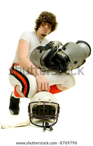 An American football player. With helmet and pads. - stock photo
