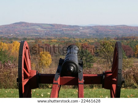 An American Revolutionary War cannon stands guard overlooking the battlefield. - stock photo