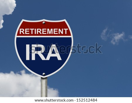 An American road interstate sign with words Retirement and IRA with sky, Your IRA Retirement Fund - stock photo