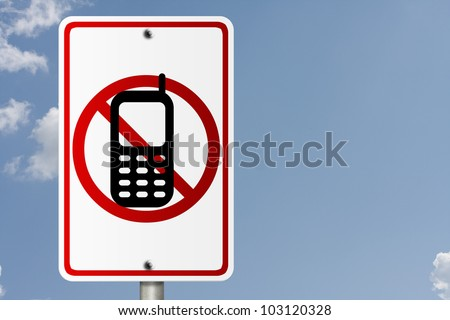 An American road sign with sky background and copy space for your message, No Cell Phones while driving - stock photo