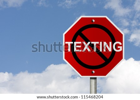 An American road sign with sky background and copy space for your message, Stop texting and driving - stock photo