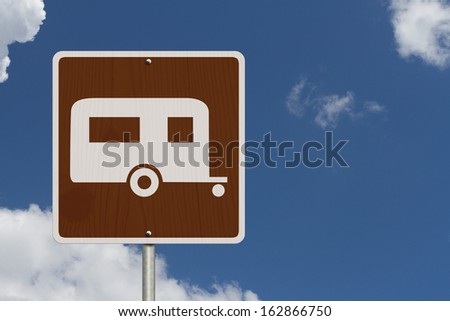 An American road sign with sky background with a symbol of a camper, Going camping